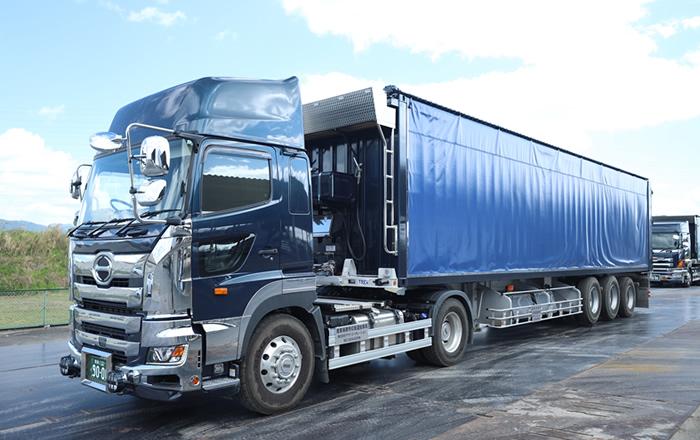 産業廃棄物運搬スライドデッキ車両